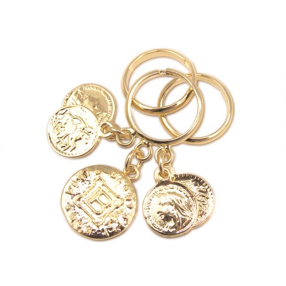 Tre anelli Laura Biagiotti in bronzo con tre monete pendenti